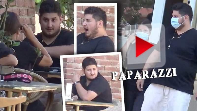 """Gabriel Oprea Jr. nu ține cont de ținută, dar nici de regulile de bun simț! A ieșit cu soția la terasă, dar """"a uitat"""" de ea! / VIDEO PAPARAZZI"""