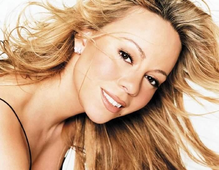 Mariah Carey s-a făcut de râs cu o ţinută prea mulată! Sânii pe jumătate ieşiţi din cupe şi burta imensă i-au oripilat pe fani!