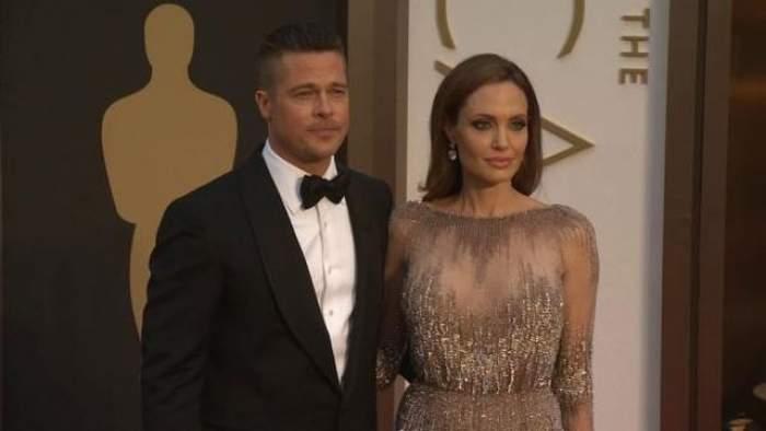 FOTO Nu credeai că o să-l vezi aşa vreodată! Îmbrăcat la patru ace la premiile Oscar, Brad Pitt muşcă cu poftă dintr-o felie de pizza, spre amuzamentul Angelinei Jolie