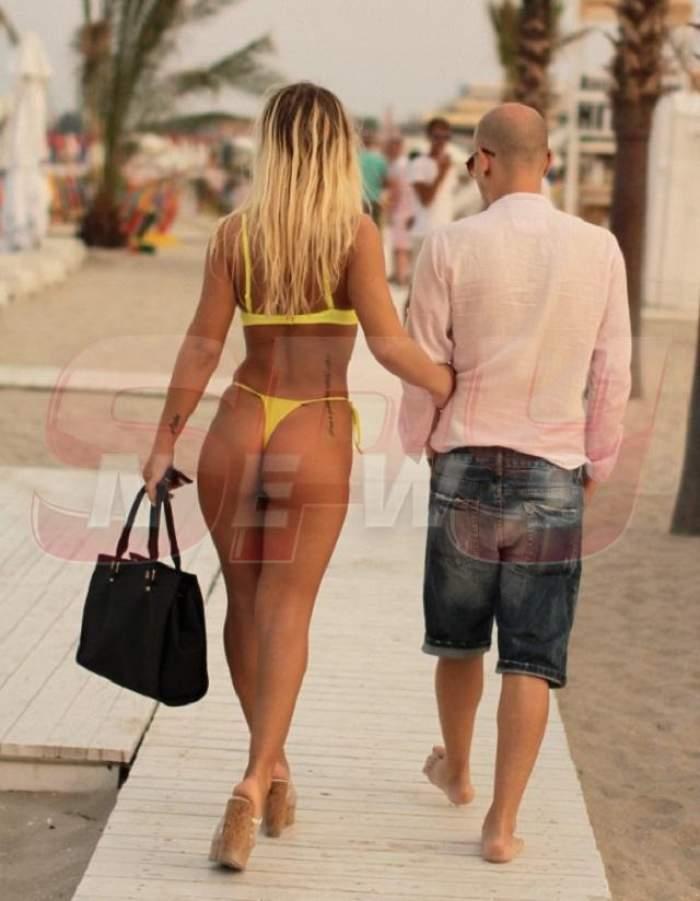 S-au încins atât de tare sub palmier...Un celebru DJ și iubita lui, la un pas să facă sex pe plajă!