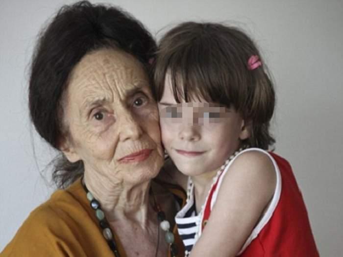 Adriana Iliescu este bună de plată! De ce este obligată cea mai bătrână mamă din România să ia bani de la gura fetiţei!