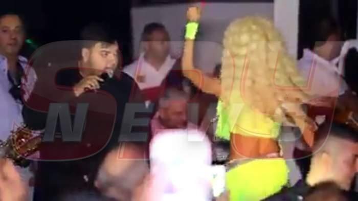 Când Roxana e acasă, Florin Salam își face de cap prin străinătate... cu o blondă siliconată!
