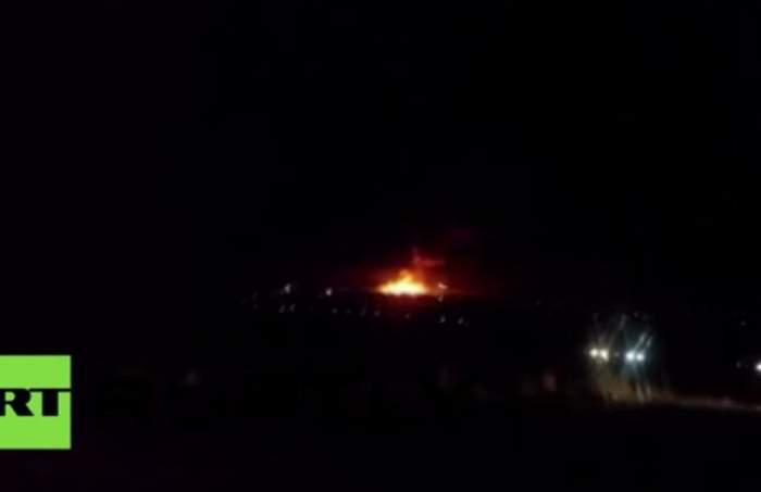 VIDEO /  Incendiu de proporţii şi explozii la un depozit militar! Cel puţin o persoană a murit