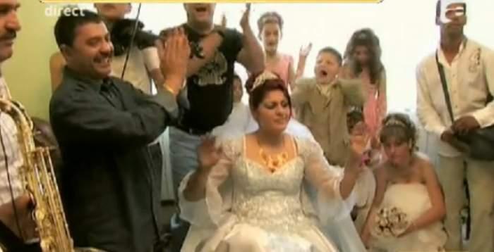 VIDEO / A plouat cu bani, diamante şi rubine! Imagini de la mega nunta din familia lui Nicolae Guţă