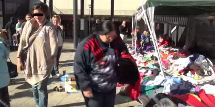 VIDEO RUŞINOS /  O româncă a fost prinsă când fura din hainele donate refugiaţilor. Reacţia ei e SCANDALOASĂ