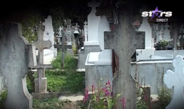 Un preot din Argeş, acuzat de profanare de morminte! Osemintele zac împrăştiate în cimitir şi în pungi