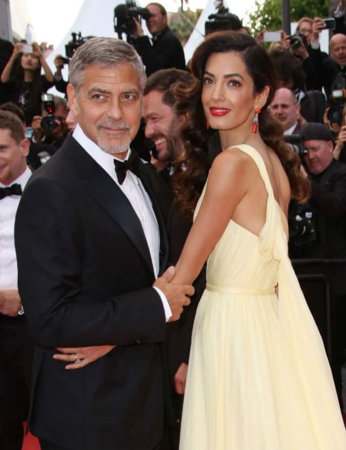 VIDEO & FOTO / Incredibil! Soţia lui George Clooney, îmbrăcată într-o ROCHIE-FUROU