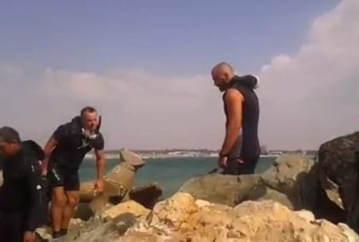 VIDEO / Alertă la mare! Scafandrii intervin pentru scoaterea trupului unui tânăr dintre stabilopozi