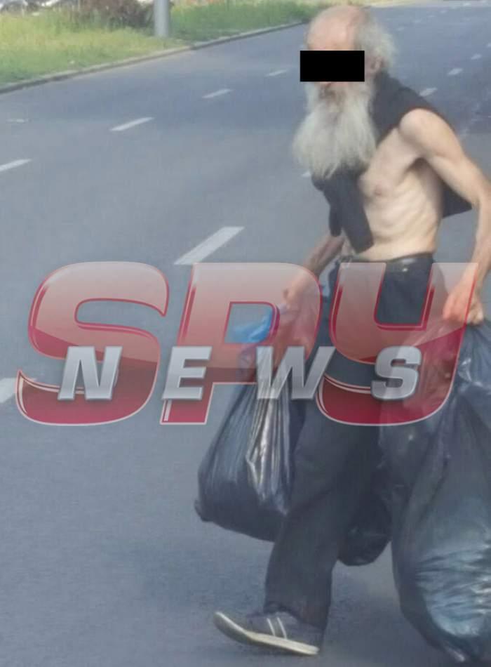 FOTO/ Imagini şocante cu un profesor din Bucureşti! Bărbatul caută prin gunoaie şi cară totul după el