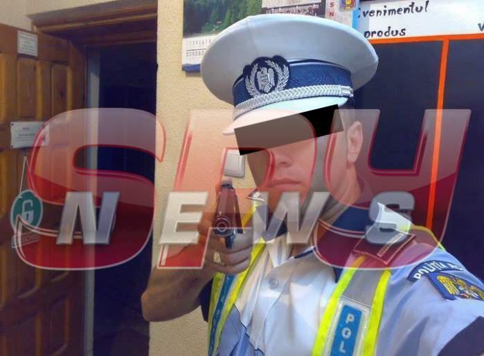 Om al legii, selfie jenant chiar în secţia de poliţie! Nici piţipoancele nu se pozează aşa!