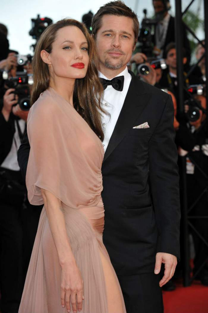 FOTO / Motivul divorţului: Brad Pitt ar fi înşelat-o pe Angelina Jolie!