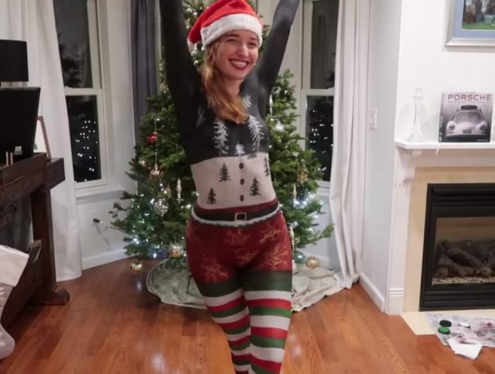 VIDEO / Ea este tânăra care s-a plimbat dezbrăcată și acoperită doar de vopsea festivă! Oamenii au fost uluiți