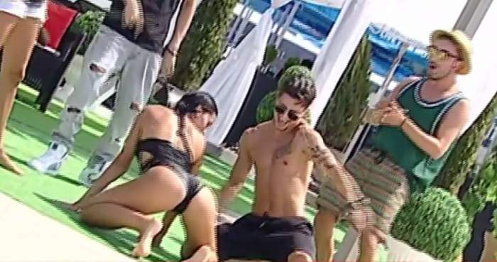 VIDEO / Raluca Dumitru, dans incendiar în costum de baie cu un bărbat HOT! Răzvan Botezatu, mai gelos ca niciodată