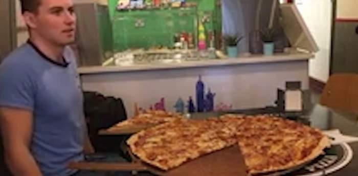 """VIDEO / Duci mult când vine vorba de mâncare? O pizzerie te răsplăteşte cu 500 de euro dacă poţi mânca aşa """"monstru"""""""
