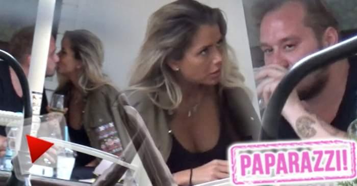 VIDEO PAPARAZZI / Un nou cuplu a apărut în lumea mondenă! Fiul unui afacerist celebru s-a combinat cu o bunăciune! Sărut pasional în public