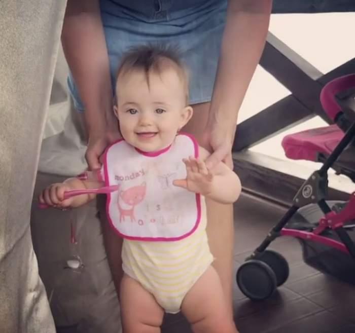 VIDEO / Victoria a făcut primii pași. Imagini de pus în ramă cu micuța Gabrielei Cristea și a lui Tavi  Clonda