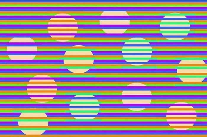 O nouă iluzie optică a devenit virală şi a stârnit isterie pe internet. Tu ce culoare vezi că au cercurile?