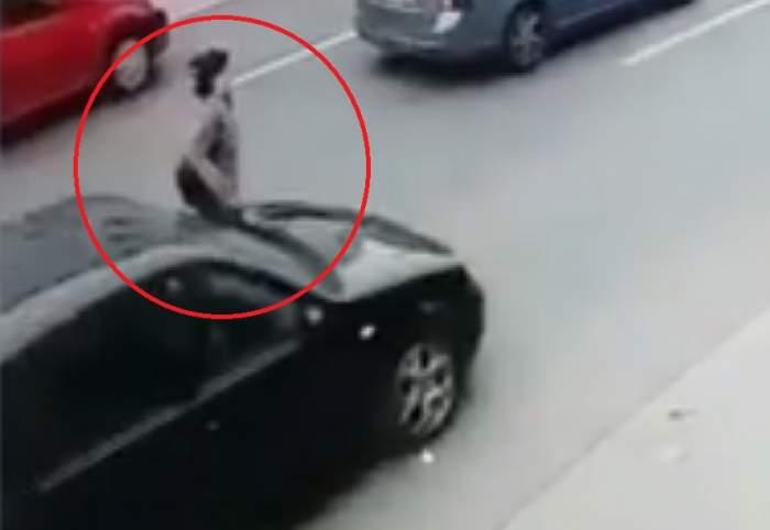 O tânără în vârstă de 29 de ani s-a aruncat în faţa unei maşini! Momentul a fost filmat. VIDEO