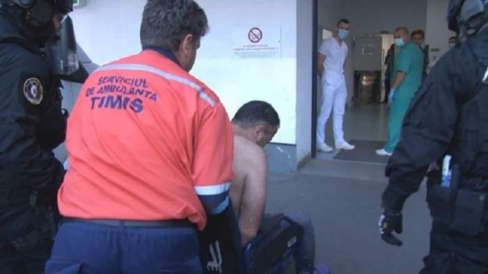 Criminalul poliţistului Cristian Amariei a fost dus la Spitalul Municipal din Timisoara sub escortă. VIDEO