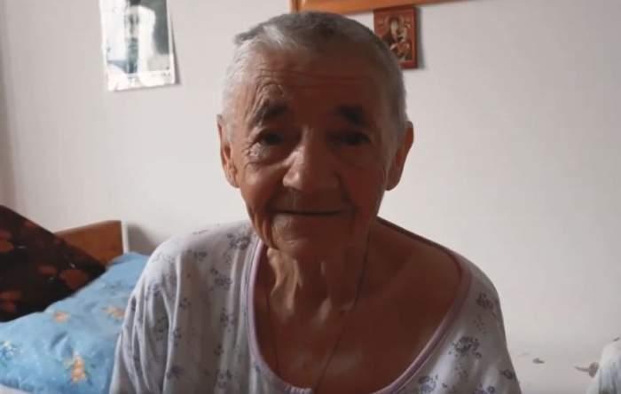 """Bătrâna care îl acuză pe un preot din Constanţa că a abandonat-o în munţi şi i-a luat casa, criticată de vecini. """"Ea s-a oferit să i-o dea"""""""