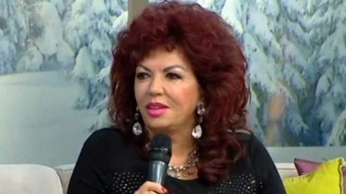 Carmen Harra la o emisiune TV în rochie neagră