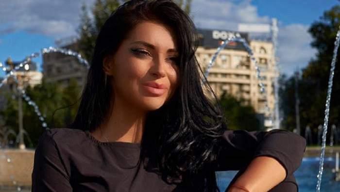 Elena Ionescu poarta o bluza neagra si parul desprins