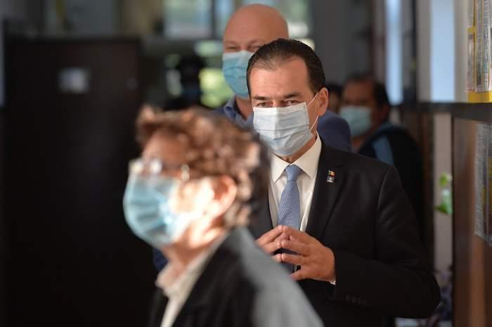 Ludovic Orban cu mască pe față.