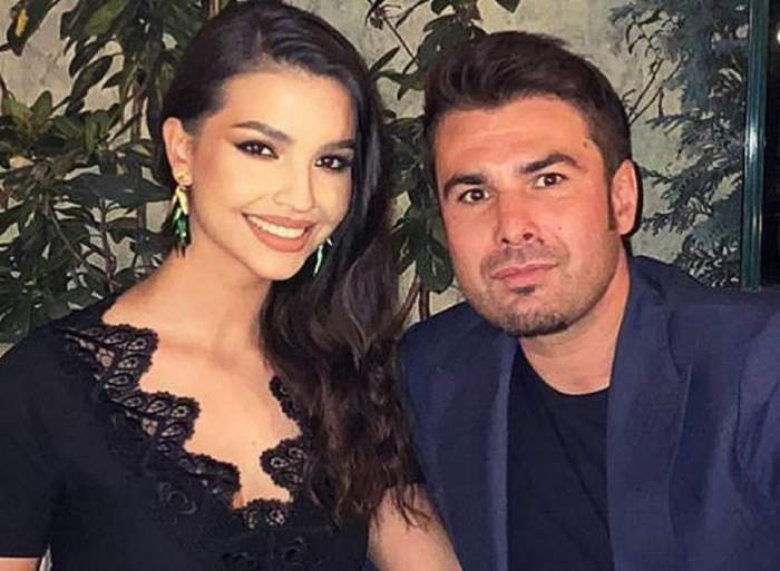 Adrian Mutu și soția lui, Sandra. Ea poartă o rochie neagră, iar el un costum albastru.