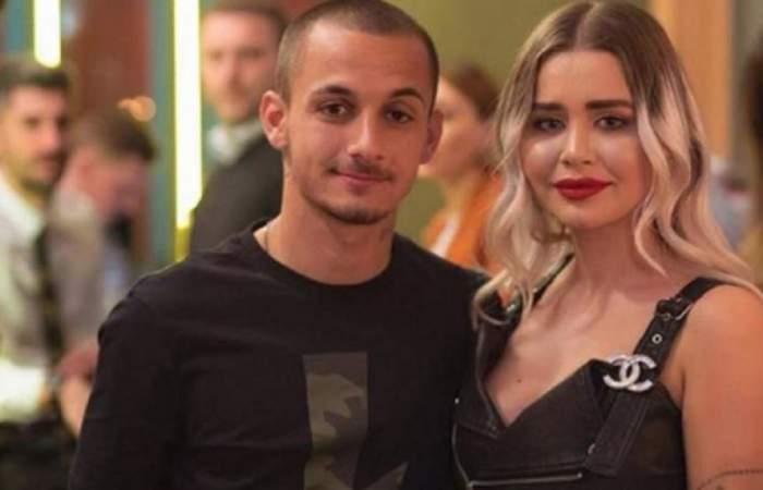 Alexandru Mitriță și soția lui, Alesia. El poartă un tricou negru, iar ea o rochie neagră.