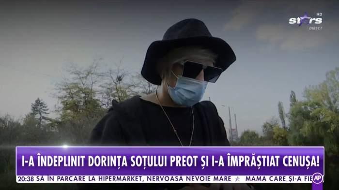 Florin Marin poarta haine negre, ochelari de soare si masca de protectie. este intr-un parc din Capitala