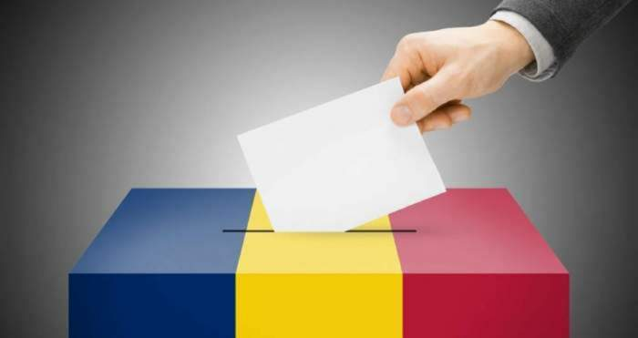 Imagine cu o urna de votare si o persoana care are un buletin de vot