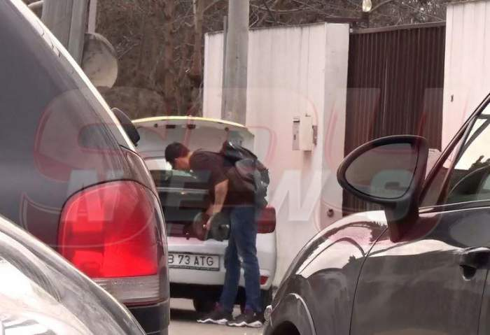 VIDEO PAPARAZZI / Primele imagini cu George Burcea, după ce Andreea Bălan a confirmat despărţirea! Actorul îşi cară lucrurile din fosta locuinţă, cu taxiul