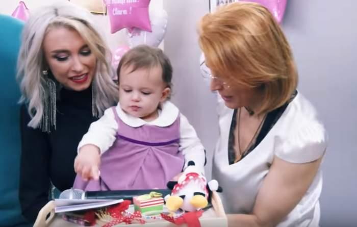 VIDEO / Primele imagini de la petrecerea de un an a fetiței Andreei Bălan. Ce obiecte a ales Clara la ruperea turtei