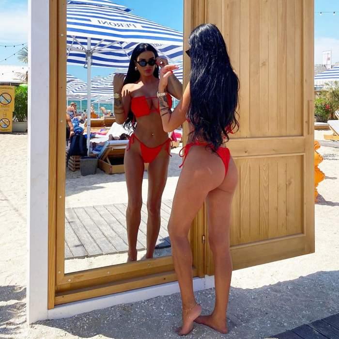 Daniela Crudu și-a lăsat formele apetisante la vedere la malul mării! Focoasa brunetă a făcut furori pe plajă / FOTO