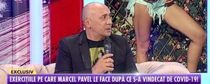 Fotografie cu Marcel Pavel în platoul emisiunii Showbiz Report