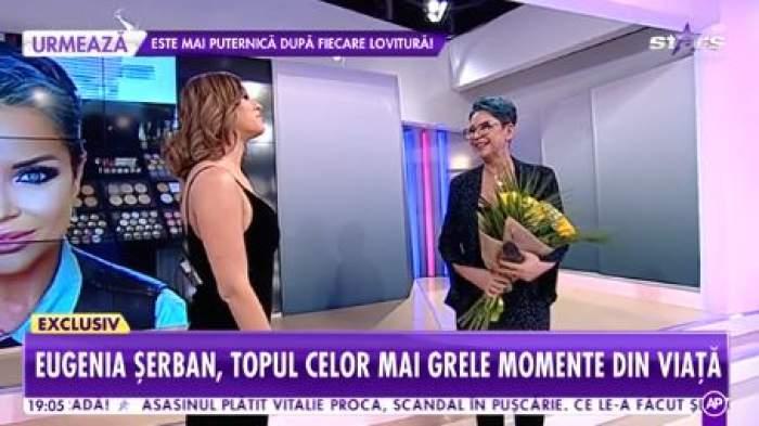 ugenia Șerban, îmbrăcată în negru la Showbiz Report, cu flori în brațe