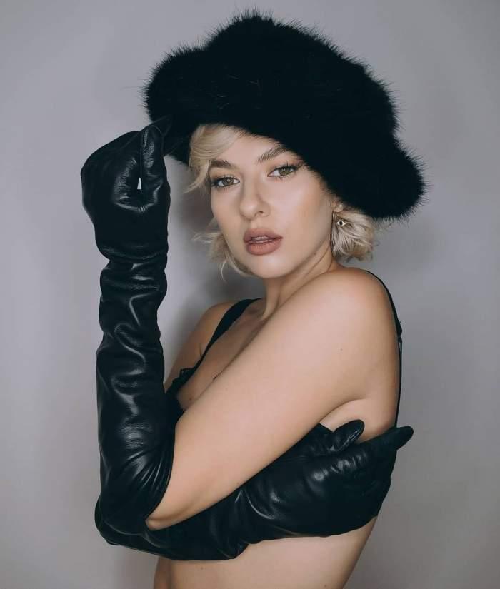 Lidia Buble cu căciulă neagră în cap, ședință foto.