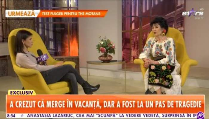 Neta Soare, în ținută tradiționaă oferă un interviu reporterului Antena Stars