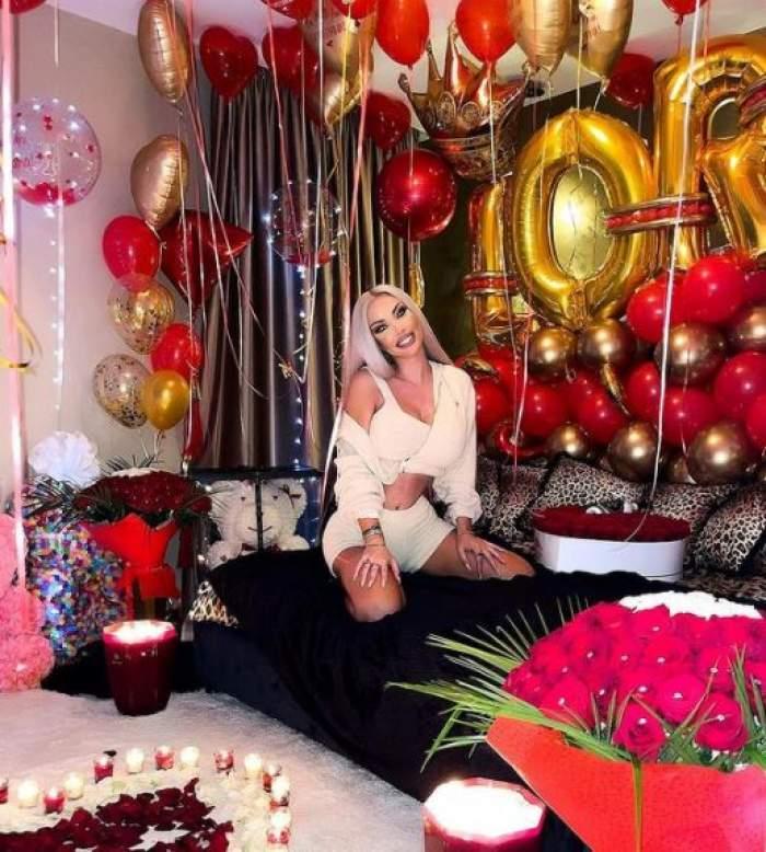 Loredana Chivu, în pat, înconjurată de flori, baloane, ursuleți și lumânări