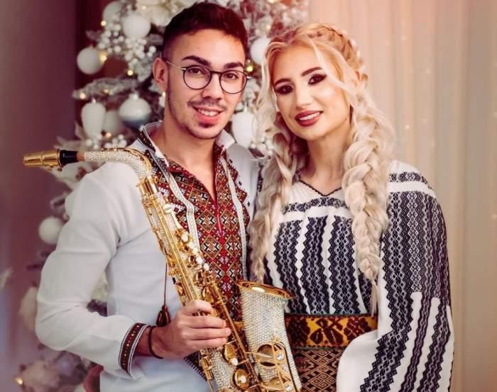 Armin Nicoară și Claudia Puican, fotografiați cu saxofonul în brațe