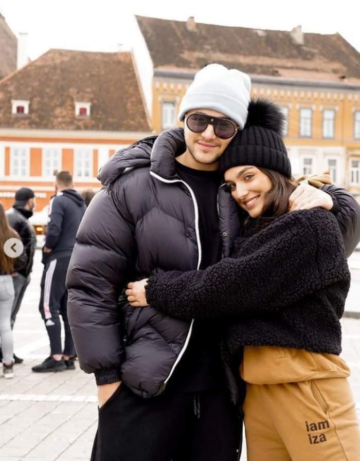 Alexia Eram si Mario Fresh sunt la munte, sunt imbracati gros si se tin in brate