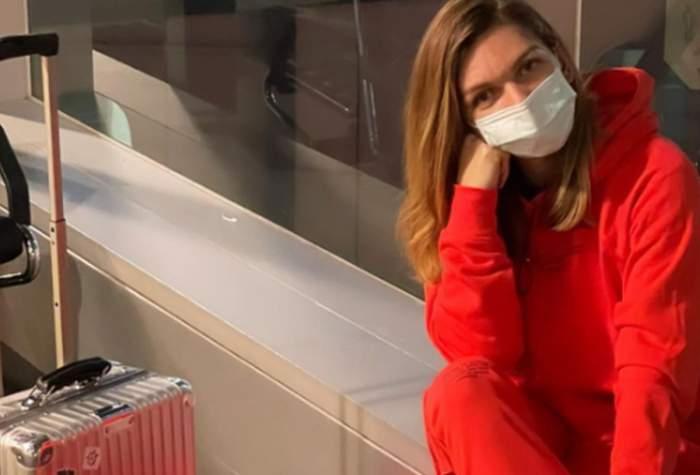 simona halep imbracata in trening rosu in aeroport