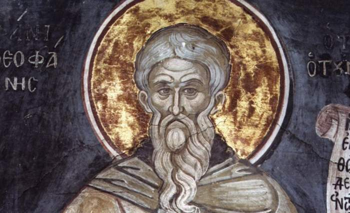 O icoană cu Sfântul Teofan Mărturisitorul. Acesta ține în mână un pergament și poartă veșminte gri.