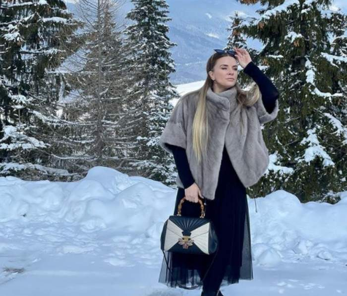 marcela fota imbracata in haina groasa la munte