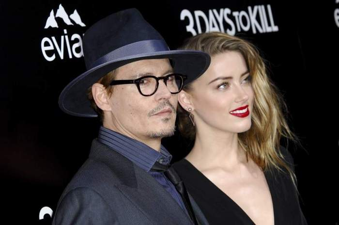 Johhny Depp si Amber Heard, imbracati elegant pe covorul rosu
