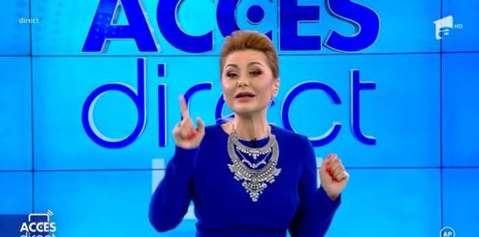 emilia ghinescu in costum albastru si cu parul prins la acces direct