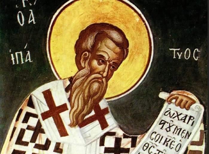 Icoană cu Sfântul Ipatie. Acesta citește un pergament și poartă veșminte albe pe care sunt desenate cruci maro și negre.