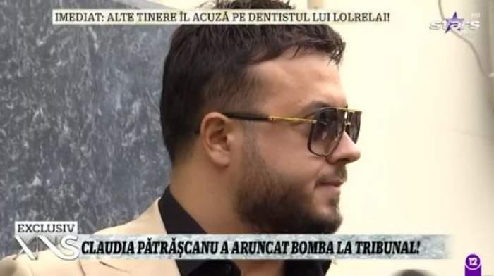 Gabi Bădălău, la costum și cu ochelari de soare