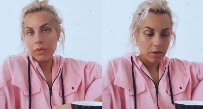 Amna poartă un hanorac roz. Vedeta ține în mâini o cană neagră.