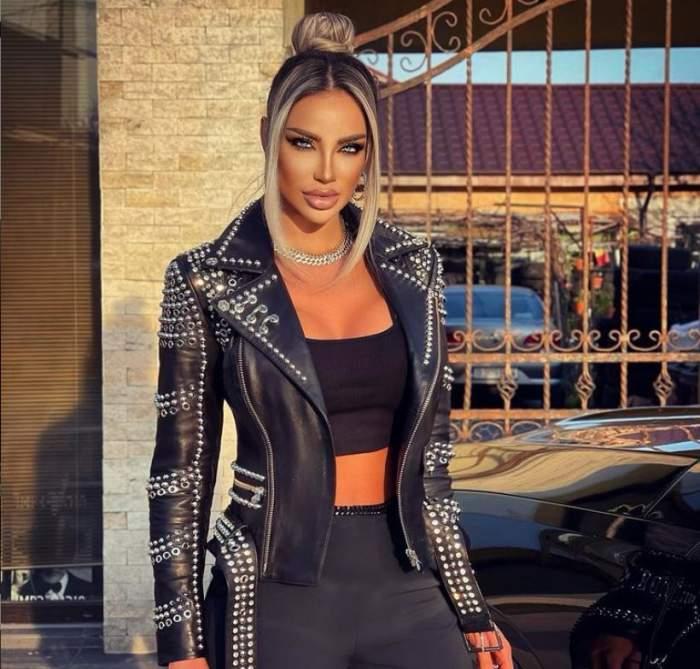 Bianca Dragusanu este afara, poarta kacheta de piele neagra si haine negre